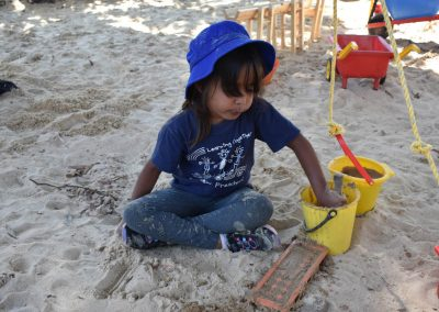 Little girl playing in sandpit