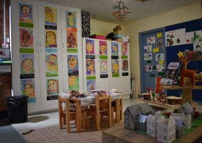Play area corner displaying childrens paintings