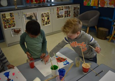 two-children-painting-on-table
